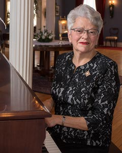 Her Honour, Antoinette Perry, Lieutenant Governor of Prince Edward Island, playing the grand piano at Government House