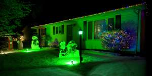 Exterior shot of bungalow decorated for the holiday season