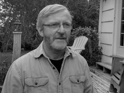 John Martin standing in his backyard