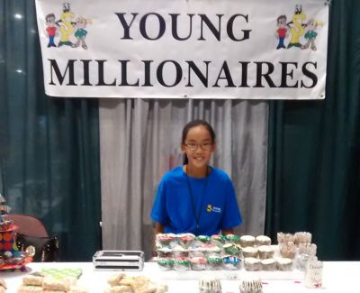 Olivia displayed her baked goods at a Young Millionaires event