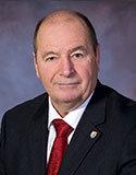 Honourable  Allen F. Roach