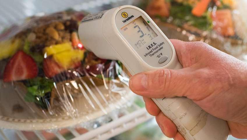 Digital thermometer reading temperature in food cooling unit
