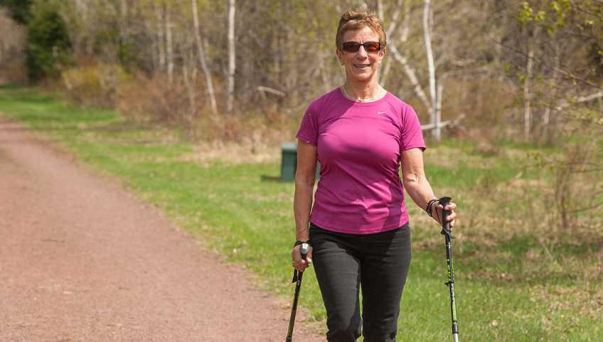 woman walking on the Confederation Trail