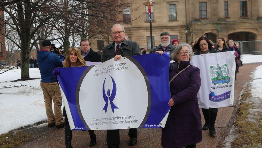 Tina Mundy, minister of Family and Human Services, Premier Wade MacLauchlan and Anne Sherman of the Premier's Action Committee on Family Violence prevention lead a parade of people from Province House in the 2016 Walk in Silence event in Charlotetown