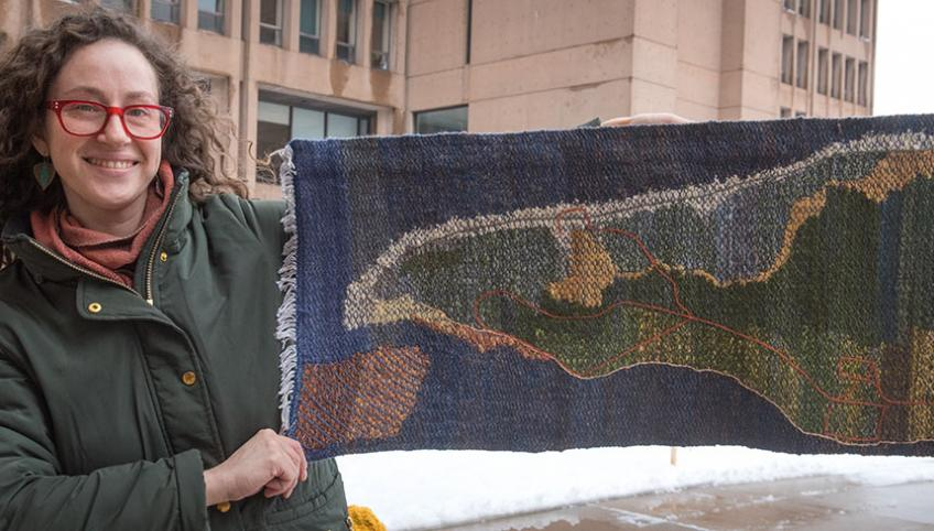 Rilla Marshall displays her artwork, a handwoven and embroidered work entitled Greenwich Peninsula, PEI