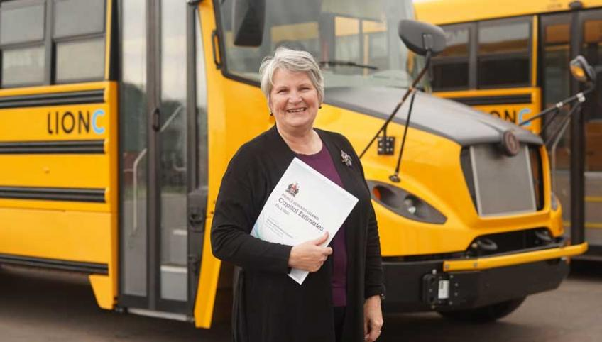 image of a person standing in front of a school bus