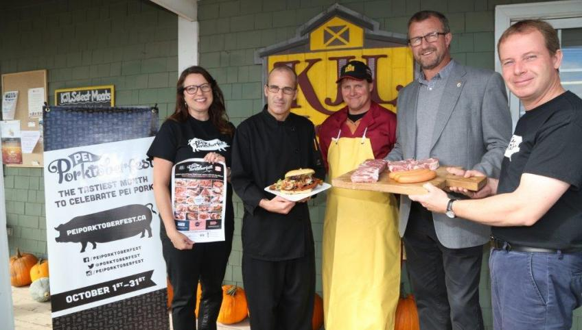 Minister Alan McIssaac and four others display Porkoberest food.
