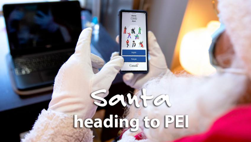 Image of Santa holding a cell phone with words on it