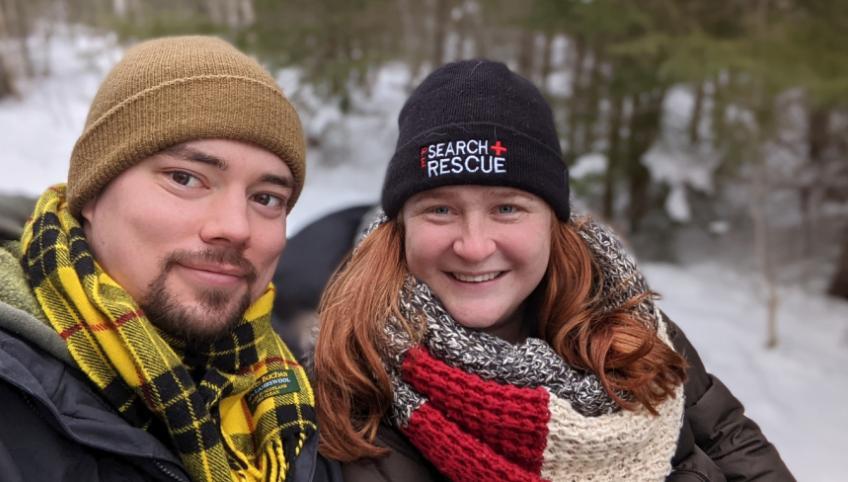 Image of two people shoulder to shoulder