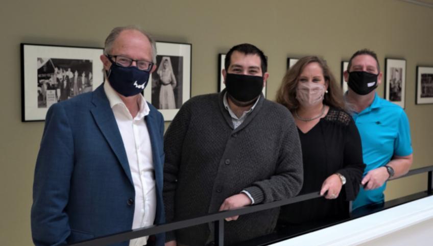 Standing against a railing: Health and Wellness Minister Ernie Hudson. Minister, Hunter Guindon, Sherri Carmichael, Ray Carmichael