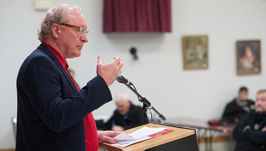 Hon. H. Wade MacLauchlan speaking at an event.