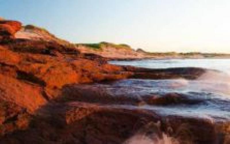 Red cliffs and sandy beach