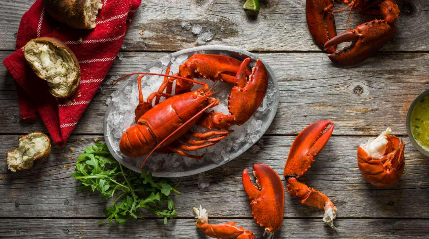 Image of lobster styled on barn board table