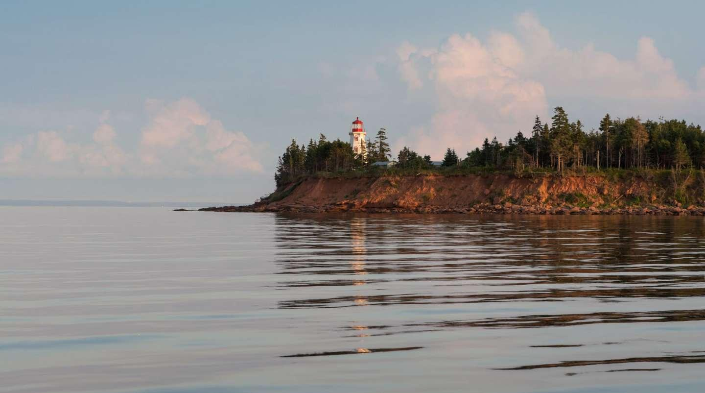 Coastline of PEI with Panmure Island lighthouse in the distance