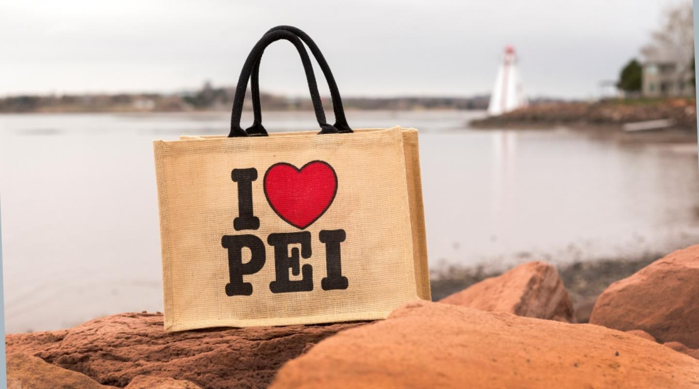 "Image of ""I love PEI"" reusable bag with Victoria Park lighthouse in background"