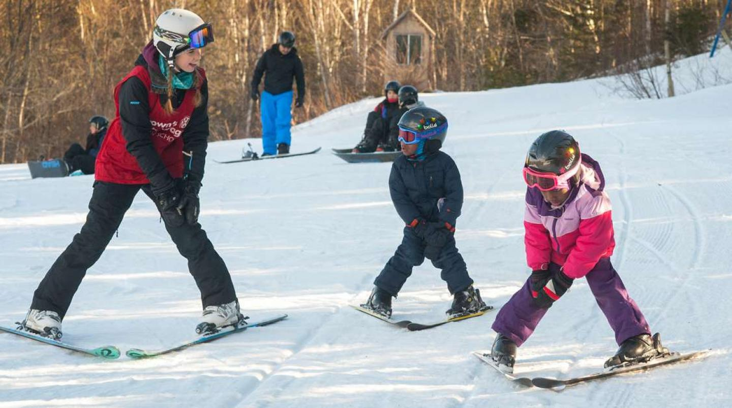 Ski instructor at Brookvale Ski Park working with young children