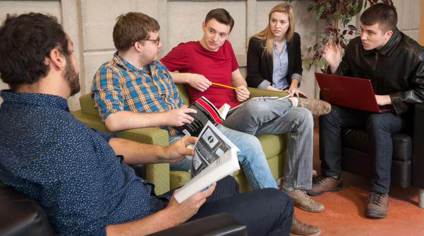 Image of group of students chatting in lobby at UPEI
