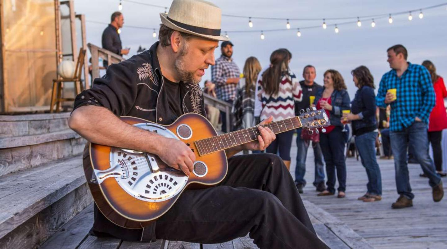 """Blues musician playing at an outdoor """"Beef and Blues"""" Fall Flavours event in Summerside"""