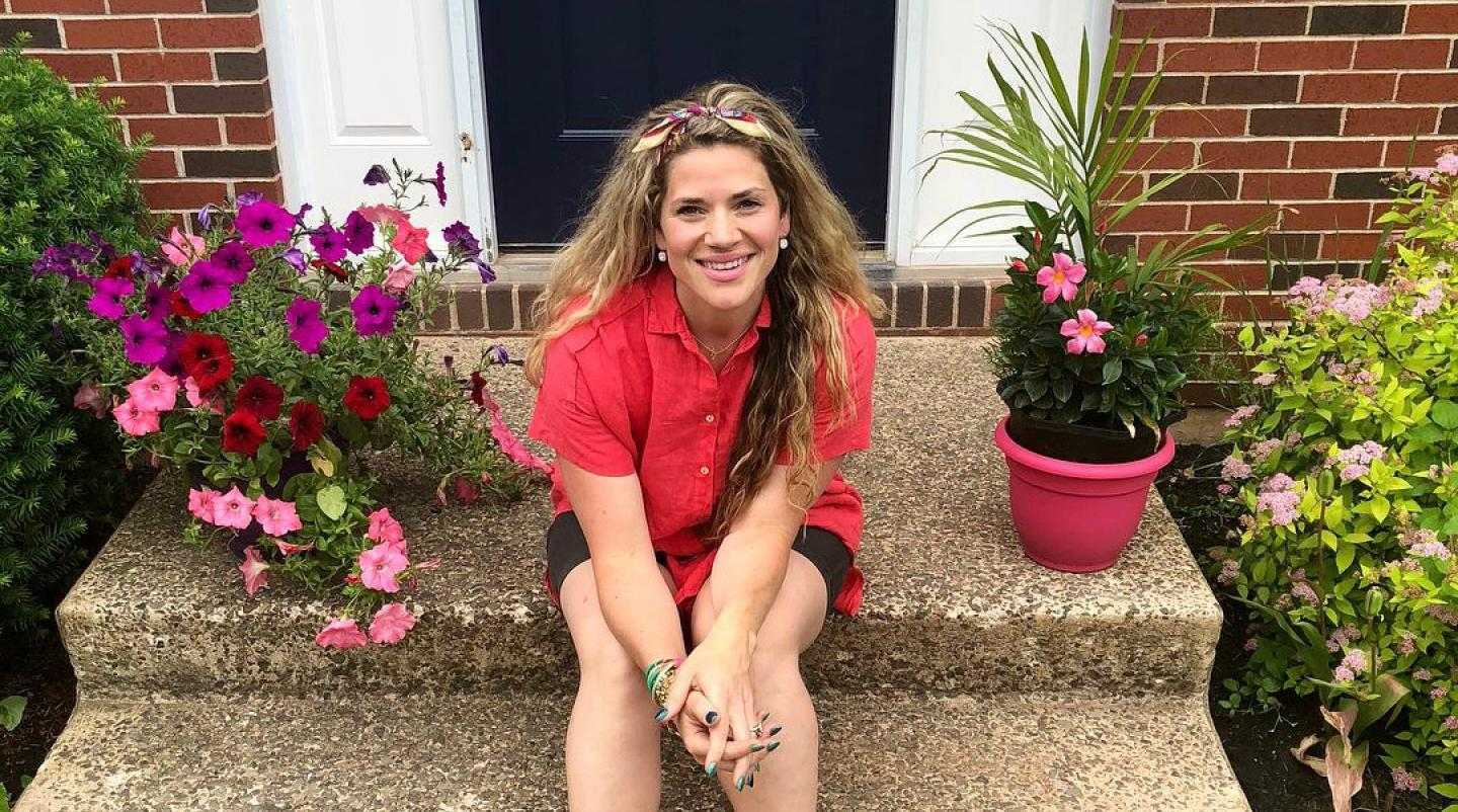 Maybe You Should Come Home to PEI Contest with Julia Campbell sits on her home door step