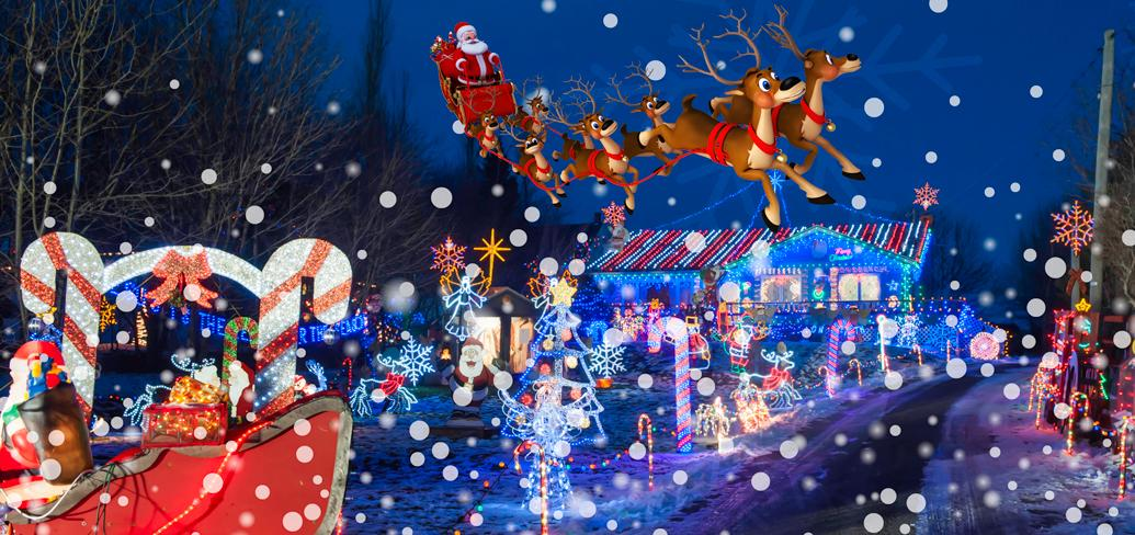 Santa in his sleigh flying over a Christmas decorated house