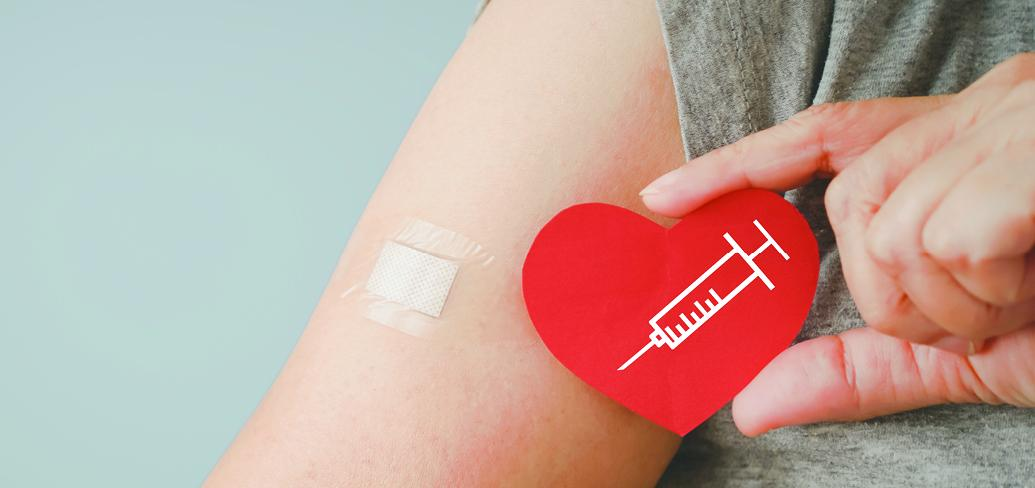 image of person's arm with a bandaid on it.