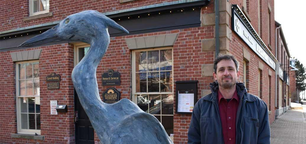 Ahmon Katz with his sculpture of a Blue Heron in Charlottetown