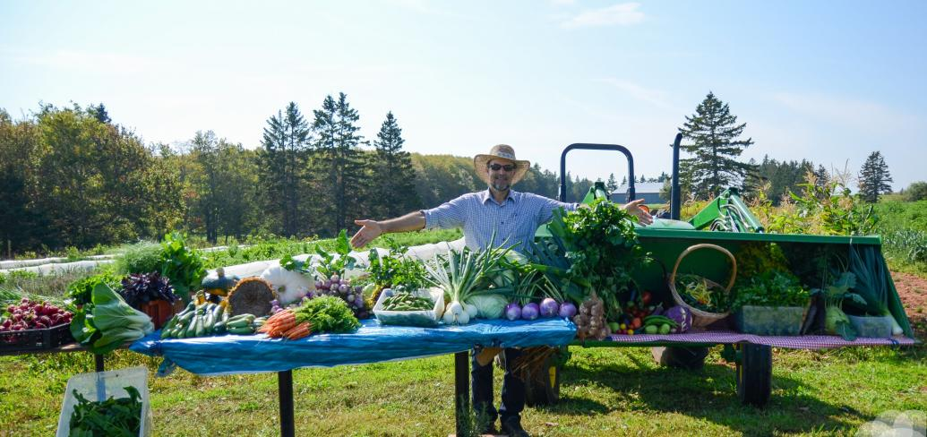 Farmer with display of produce