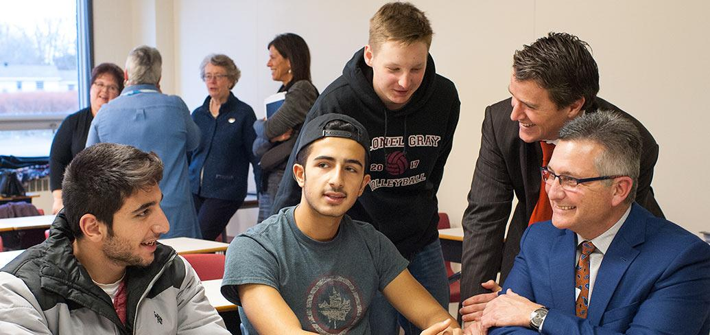 Photo shows ministers Jordan Brown and Heath MacDonald with students