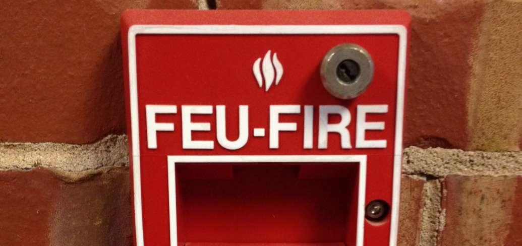 Image of fire alarm mounted on a brick wall