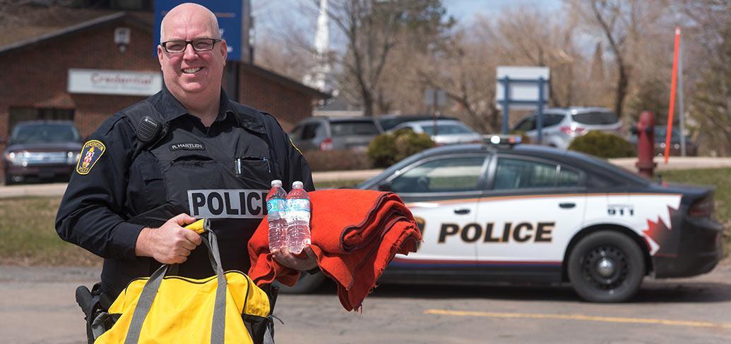 Man holding emergency supplies.