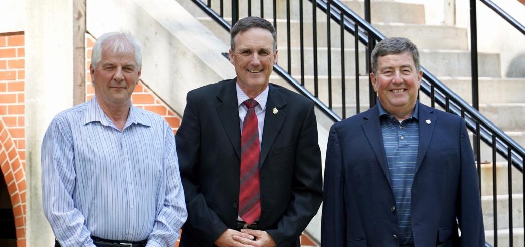 Minister Jamie Fox stands outside the Coles Building representatives of fishers: Ian MacPherson and Bobby Jenkins