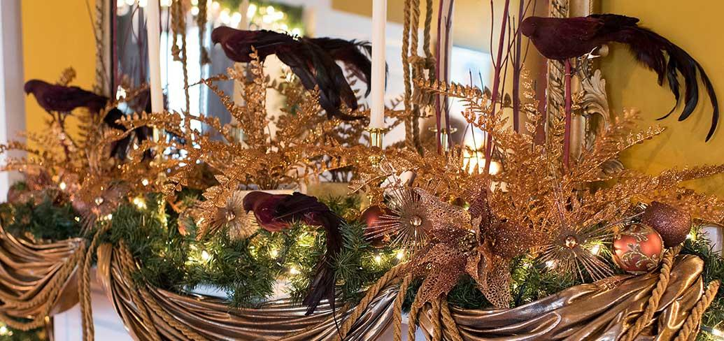 Photo shows Christmas decorations on a mantle at Government House