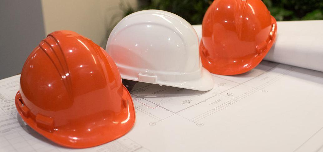 Hard hats and design plans