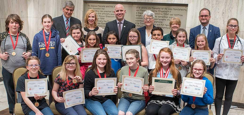 Students receive awards for their projects at the Provincial Heritage Fair.