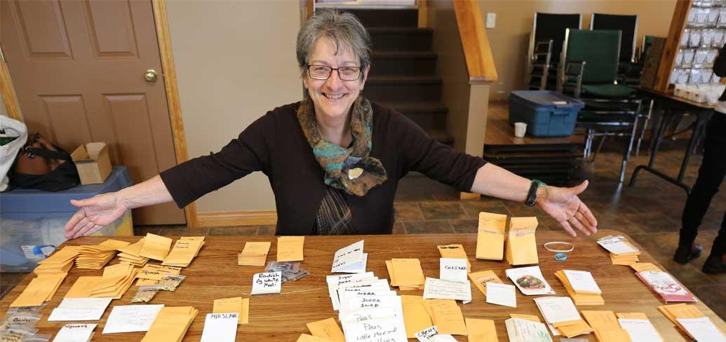 Irene Novaczek with some of the seeds available at Seedy Saturday.