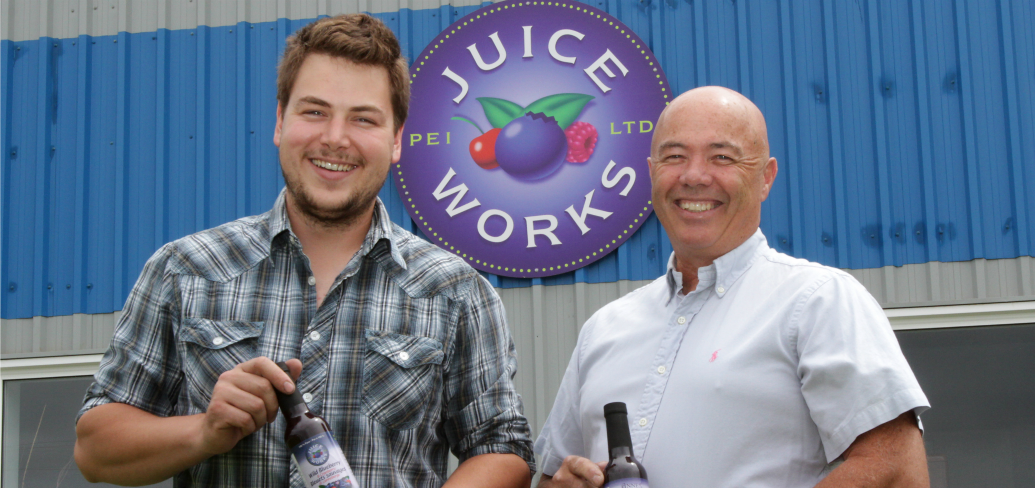 PEI Juice Works General Manager Jackson Platts, and President Denton Ellis hold bottles of the company's signature blueberry juice.
