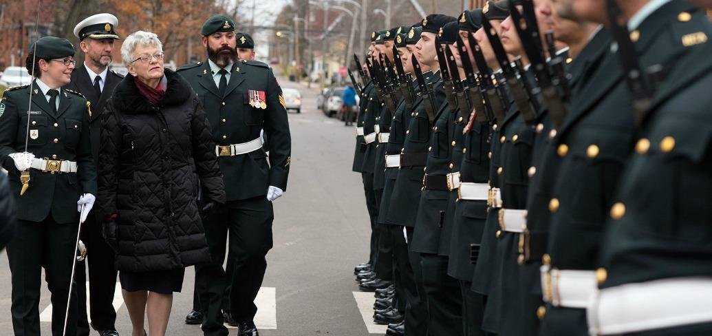 Photo shows lieutenant governor reviewing honor guard