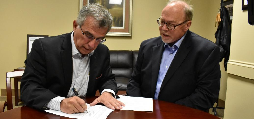 Minister Richard Brown and Maritime Electric CEO John Gaudet