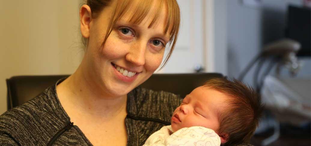 Photo shows new mom Sara McKenna and her baby Emma