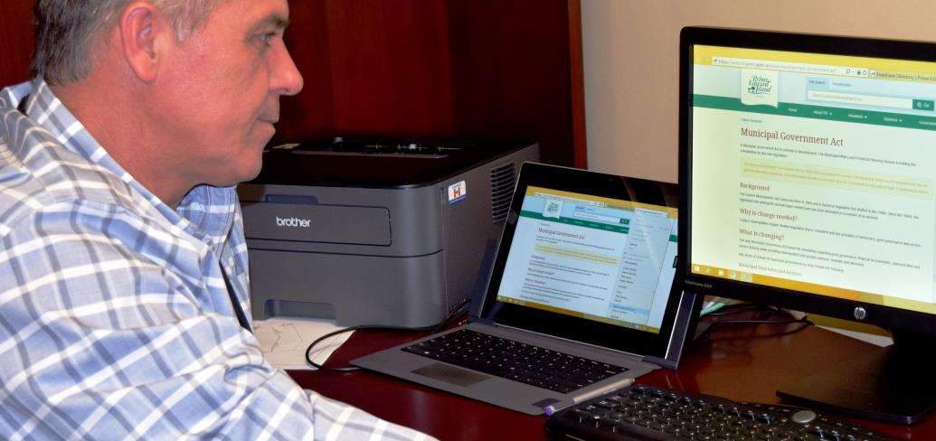 Minister of Communities, Land and Environment Robert Mitchell reviews the new department webpage that invites Islanders to submit feedback on the upcoming Municipal Government Act.