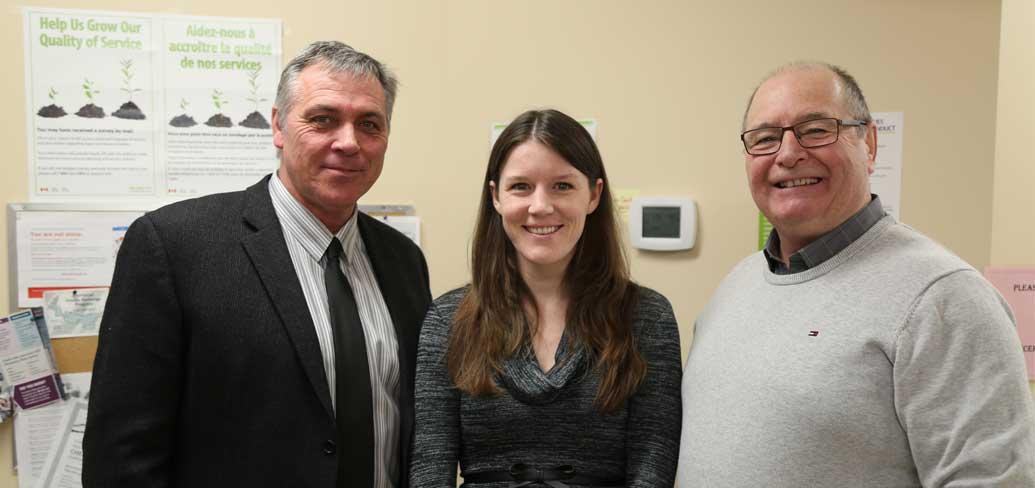 Minister Robert Mitchell and MLA Allen Roach welcome family physician Dr. Penny Thomas.