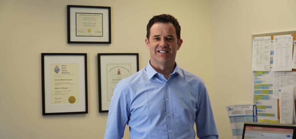 Norbert Carpenter is shown standing in his office