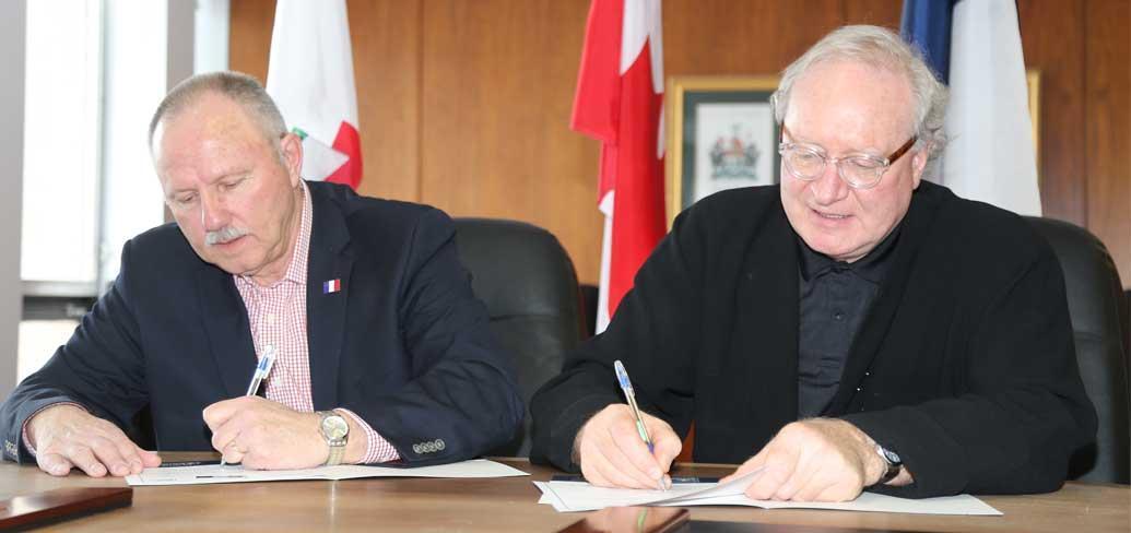 Guy LaBonté, Chair of the Société Saint-Thomas-d'Aquin and Premier Wade MacLauchlan