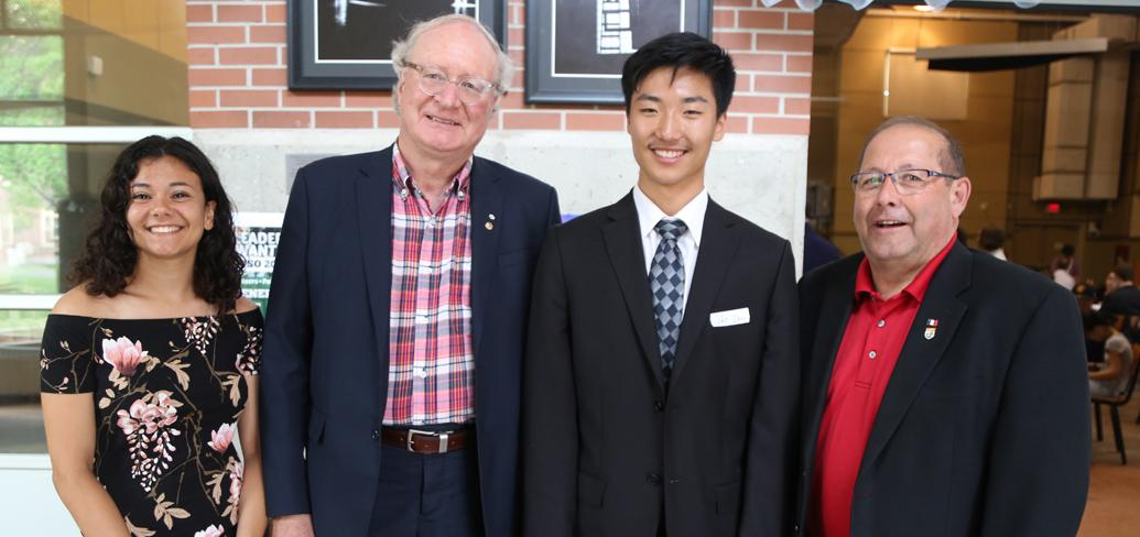 Premier Wade MacLauchlan and Minister Sonny Gallant with SHAD graduates, Zara Toupin Ramlal and John Zhou