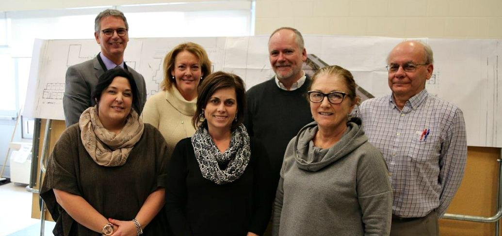 Photos shows the school renovation planning team