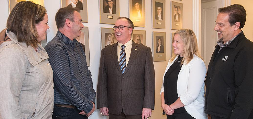 Minister Chris Palmer (centre) with TIAPEI representatives Kelly Corazza, Kirk Nicholson, Corryn Clemence, and Robert Jourdain