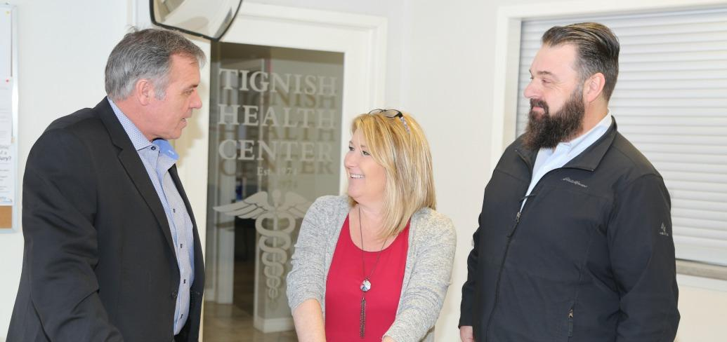 Minister Robert Mitchell, Tignish Health Centre manager Wendy Arsenault and MLA Hal Perry.