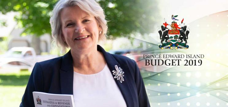 Minister Compton holding the 2019 Provincial Budget