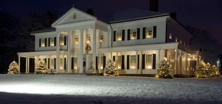 Exterior shot of Government House at night with Christmas lights