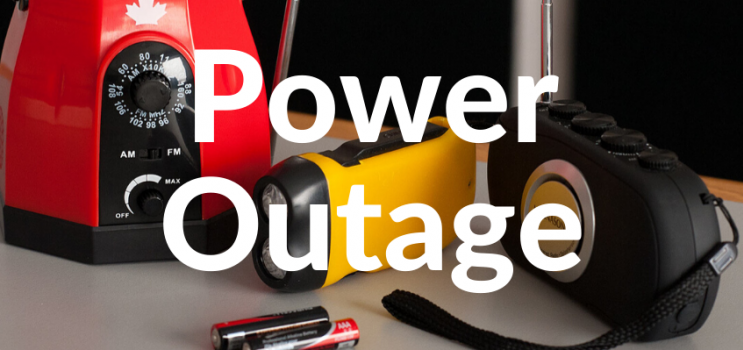 """Image of flashlight, crank radio and batteries with text """"Power Outage"""""""